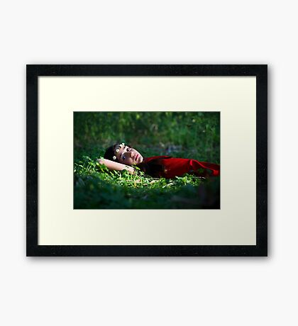 Young girl of 12 with red dress and a wreath, relaxing outdoors  Framed Print