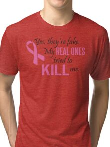 Yes, they're fake. My real ones tried to kill me! Tri-blend T-Shirt