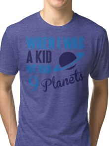 When I was a kid we had 9 planets Tri-blend T-Shirt