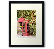 An old style telephone booth Framed Print