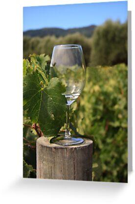 Wine glass on a log by Sue Leonard