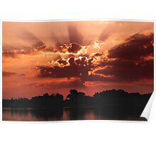 Outstanding sunset with beautiful sunbeams. Red sunset over the lake Poster