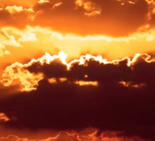 Outstanding sunset with beautiful sunbeams. Red sunset behind the clouds Sticker