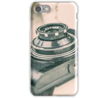 Old vintage camera on the wooden background. Retro photography iPhone Case/Skin