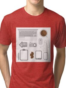 Geek illustration. Things left on the desk in order: coffee, laptop, tablet, smartphone, camera, mouse, headphones, cookies, notepad, pencil and photos. Gray colors Tri-blend T-Shirt