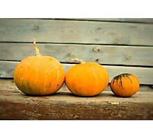 Pumpkins on a wooden background Photographic Print