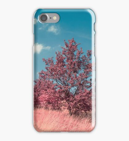 Pink trees. Infrared photo style. Summer time. A field grass with trees. Rural landscape iPhone Case/Skin