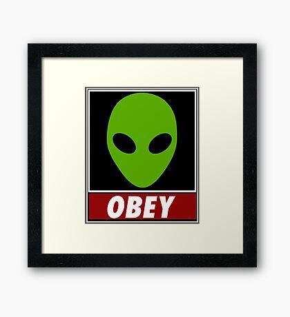 Alien Obey Framed Print