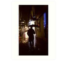 Man walking in street at night in rain color 35mm analogue photojournalism portrait photograph Art Print