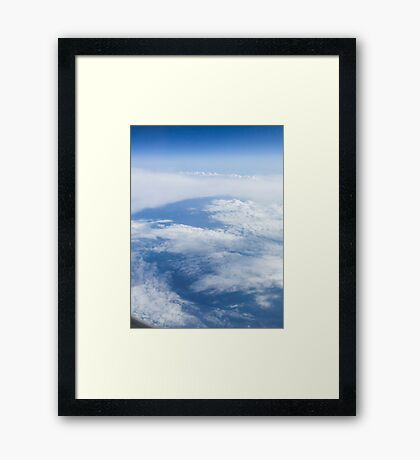 Beautiful cloudscape on a blue sky as seen from above  Framed Print