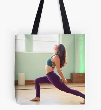 Female Yoga instructor in her studio Model release Available  Tote Bag