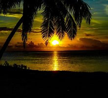 Sunset over the lagoon of Aitutaki in The Cook Islands by Luke Farmer