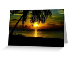Sunset over the lagoon of Aitutaki in The Cook Islands Greeting Card