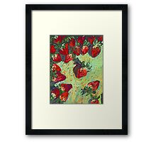 Strawberries on a table Framed Print