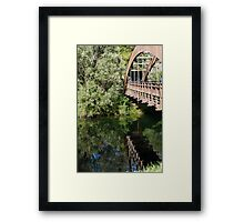 wooden bridge on the lake Framed Print