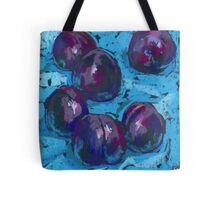 Black plums on a blue tablecloth Tote Bag