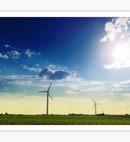 Landscape of windmills on a green field with view of the beautiful sunny sky with clouds Sticker