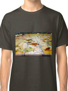 Selective focus on fallen autumn maple leaves Classic T-Shirt