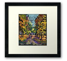 Autumn landscape with people om a park's path Framed Print