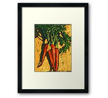 Red carrots on yellow table Framed Print