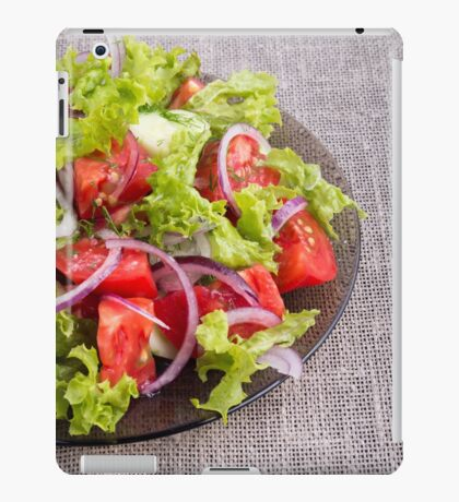 Fragment of a transparent plate with a fresh salad of raw vegetables iPad Case/Skin