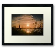 Weeding out the Sunset Framed Print