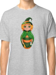 Nested doll in a suit of the witch a Halloween in a green raincoat with a sweeper and a potion in hands Classic T-Shirt