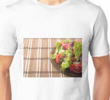 Vegetarian salad from fresh vegetables on a bamboo mat Unisex T-Shirt