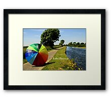 Umbrella at the canal Framed Print