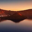 Sunrise over Wizard Island and Crater Lake. by Alex Preiss