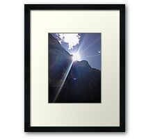 The Light Behind The Rock Framed Print