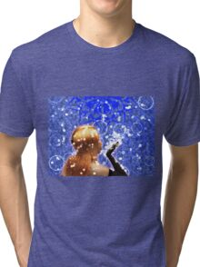 Blond girl is blowing snowflakes Tri-blend T-Shirt