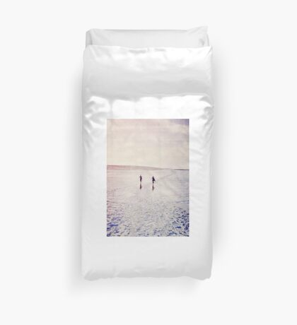 Surfers in the snow. Duvet Cover