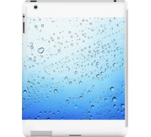 drops on a transparent surface with a blue to white gradient background iPad Case/Skin