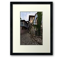 Steep and Twisting Cobblestone Street Framed Print