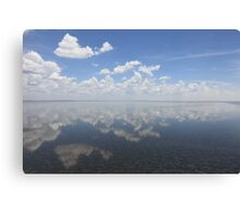 Reflection of the sky with clouds Canvas Print