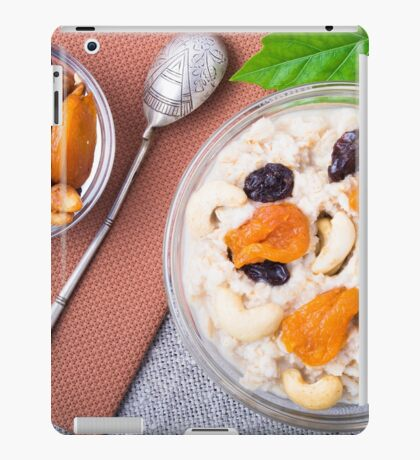 Top view of a portion of oatmeal with fruit, cashew nuts and berries iPad Case/Skin