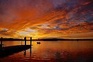 Sunrise over Coffin Bay boat ramp. by Ian Berry