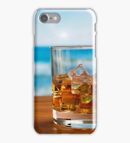 Glass of Whisky With Ice on a Wooden Table Against The Sea iPhone Case/Skin