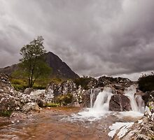 Dark skies over the Waterfall by Natuuraandemuur