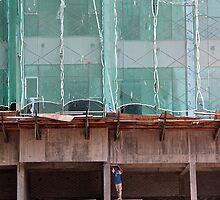 Men build Giants - Kuala Lumpur, Malaysia. by Tiffany Lenoir