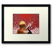 Girl blowing snow Framed Print