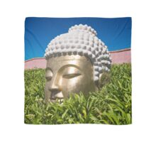 Golden Buddha among green leaves Scarf