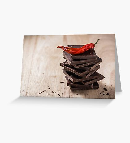 Chili on the stack of chocolate bars Greeting Card
