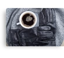 Top view of a white cup of coffee and black women's gloves Canvas Print