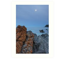 Red lichen rock and moon rise.  Art Print