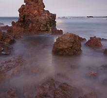 Moon rise over rock outcrop.  by Ian Hallmond