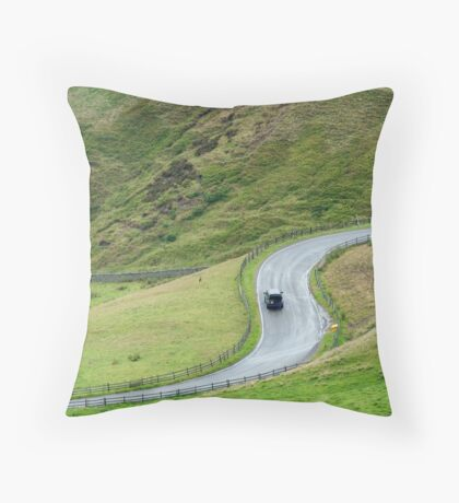 S-bend on a rural road passing through the Peak District National Park Throw Pillow