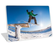 Snowboarder jumping against blue sky Laptop Skin