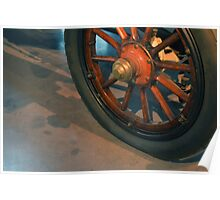 Vintage car wheel with wooden spikes.  Poster